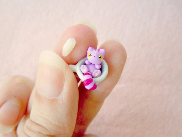 Tiny Cheshire Cat in a miniature tea cup. $23.00, via Etsy.