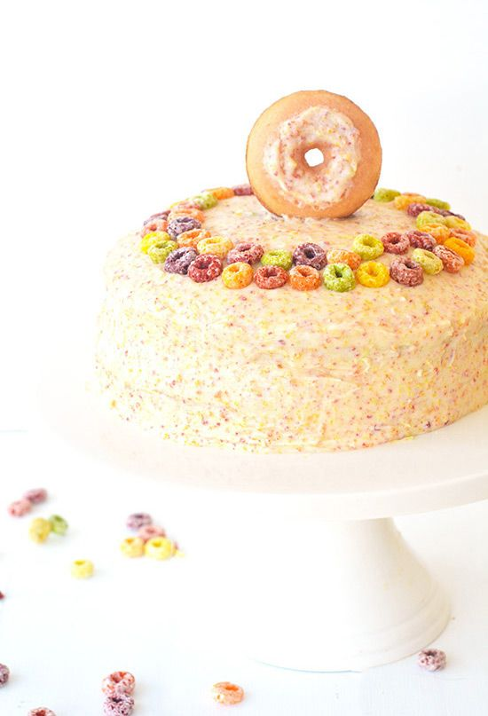 Are you all ready for this? I have a FUN cake recipe to share with you  today. This two layer fluffy butter cake has a secret ingredient - Fruit  Loop cereal milk. That's right, milk that has been infused with Fruit Loops  has been used IN the cake.  And then its been covered with sweet Fruit Loop cereal milk frosting and  decorated with Fruit Loops. It's Fruit Loop madness, I tell you. And a  cereal lover's dream come true.  I miss America! But putting my baking mittens back on a...