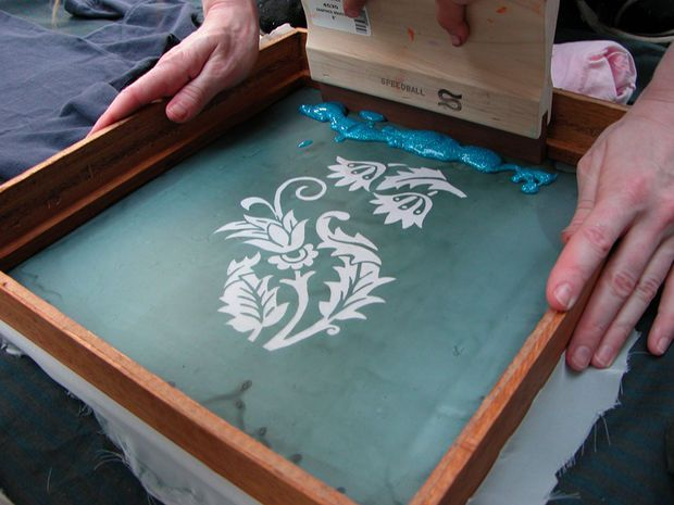 Cheap way to screen print.  http://www.guardian.co.uk/lifeandstyle/2010/may/11/how-to-screen-print-tshirts-at-home