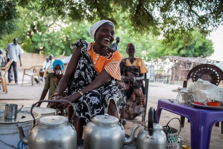 Thirty-three-year-old Martha sells tea from a small stall in Leer, #SouthSudan. She is an internally displaced person and was one of a number of women who were so worried about their sons being forced to join a rebel army that they offered to fight in place of their children.  © UNHCR/A.McConnell