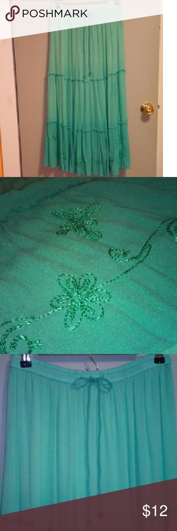 Like new maxi skirt Like new, a light green turquoise color, elastic waist with drawstring for adjustment, length is 35 inches, has flower embroidery on the front bottom of skirt in matching thread, no pockets, size 4-6 Skirts