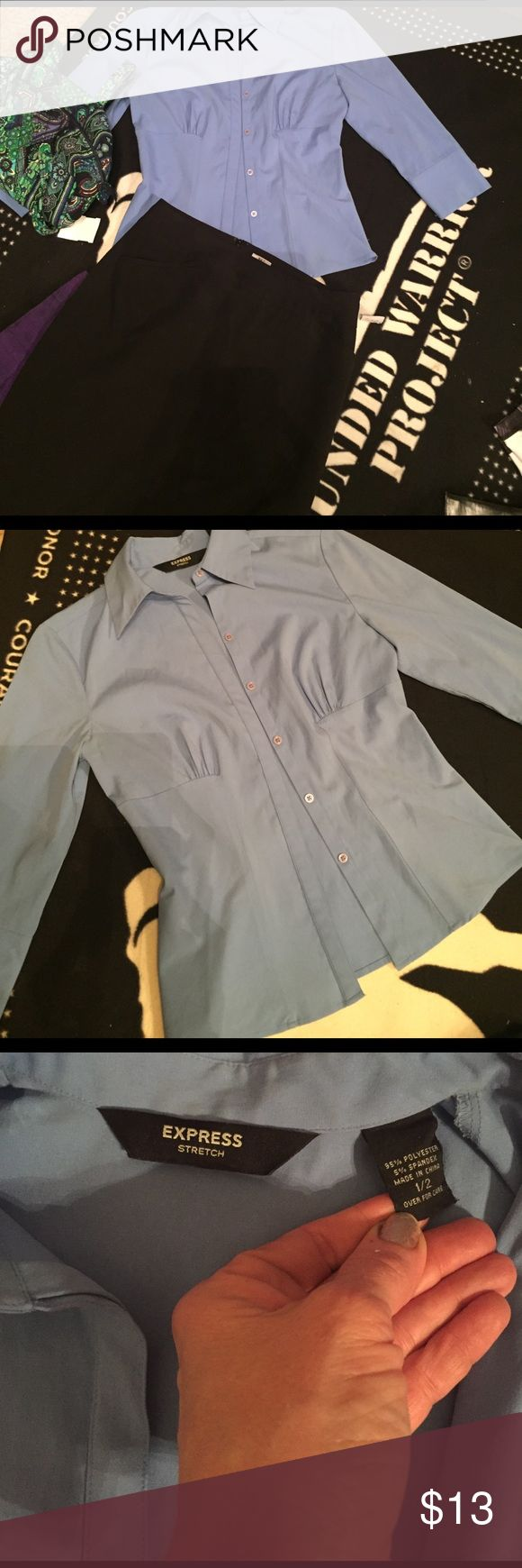 Women's fitted baby blue dress shirt Express 1/2 Very nice Express fitted sliming dress shirt in baby blue. Tapered at waist and shows off your curves! Very flattering shirt! Size says 1/2 and it has 3/4 sleeves Express Tops Button Down Shirts