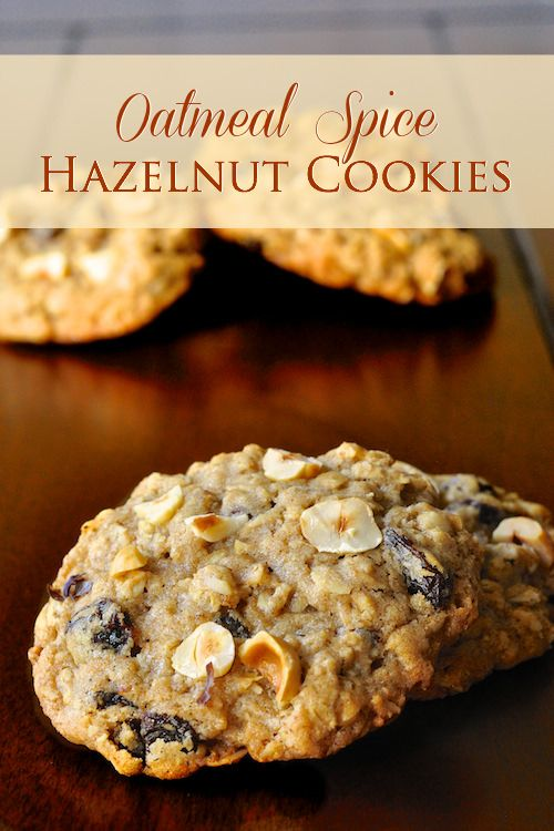 Oatmeal Spice Hazelnut Cookies - chewy, crunchy delicious! These hazelnut cookies take the best of a chewy oatmeal cookie & adds raisins, crunchy hazelnuts & fragrant spices making them great for Holiday baking too.