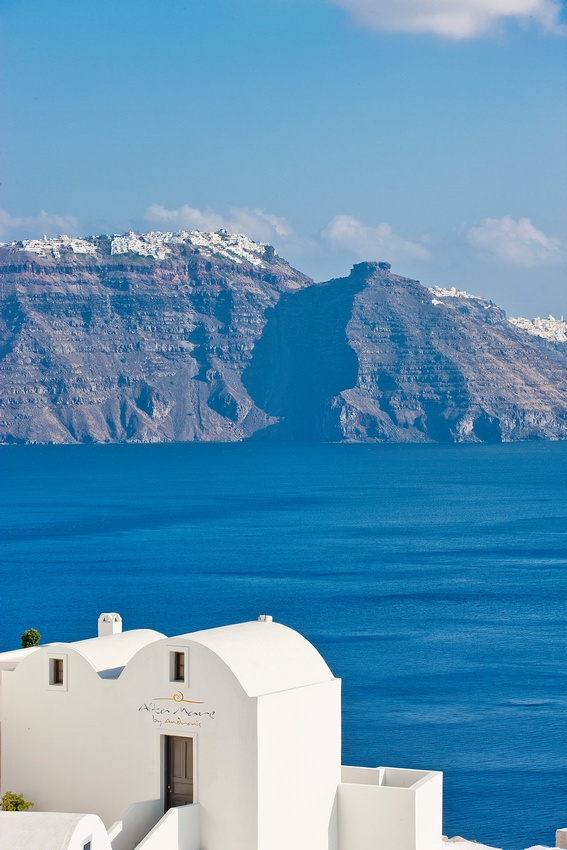 Those are not white caps across the caldera, they are houses, Santorini, Greece