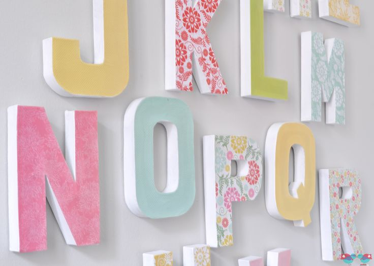 DIY Letter Wall - Make a big, colorful statement piece with an inexpensive home decor craft. {The Love Nerds} #letterdecor #modpodge #paperm...
