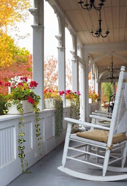 This could possibly be the front porch at an Inn or a Bed and Breakfast and it's lovely. via