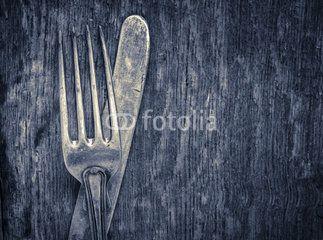 Vintage silverware on rustic wooden background