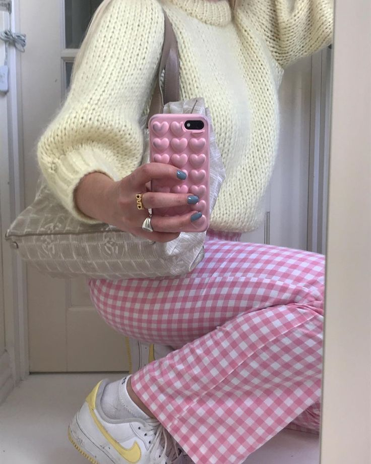 Super cute pink and white gingham check pants worn with nike sneakers and a cute fuzzy sweater - this is casual outfit inspiration