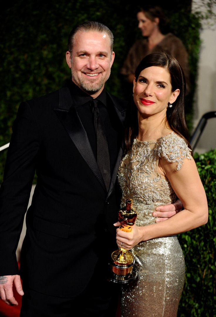 """Sandra Bullock fell for tattooed motorcycle man Jesse James in 2003. The two met when Sandra had arranged for her 10-year-old godson to meet the """"Monster Garage"""" star. Sandra and Jesse married two years later in July 2005."""