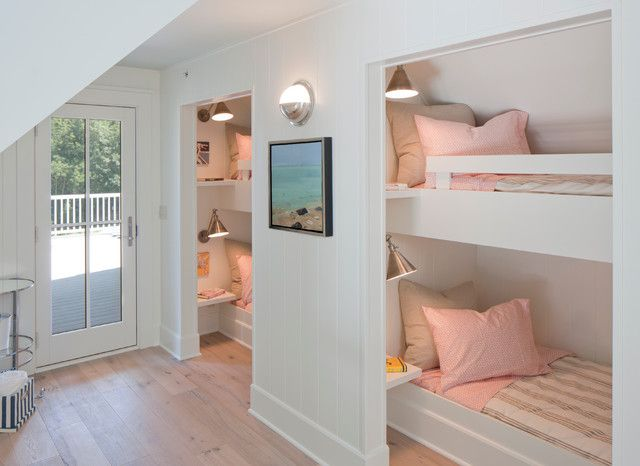 Francesca Owings Interior Design    Girls' bunk room features built-in bunk beds dressed in pink and gray bedding accented with floating bedside tables and reading lights.