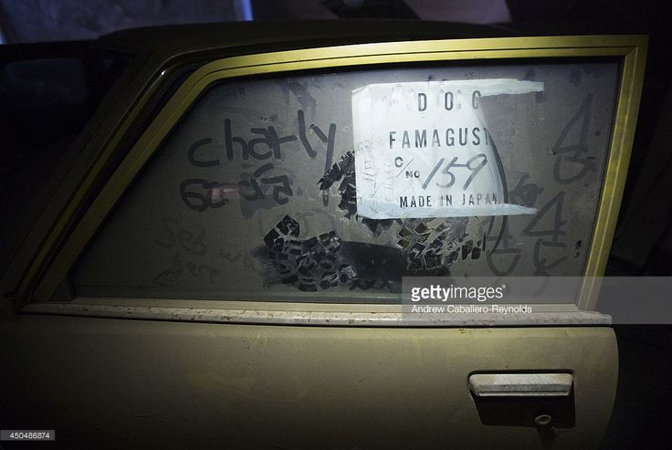 An imported car from Japan, with a customs note from Famagusta port, sits covered in dust on June 12, 2014 in Nicosia, Cyprus, after it was left in the buffer zone in 1974. The buffer zone is patrolled by The United Nations Peacekeeping Force in Cyprus (UNFICYP), and originally set up by the Security Council in 1964 to prevent further fighting between the Greek Cypriot and Turkish Cypriot communities. After the hostilities of 1974 and in the absence of a political settlement to the Cyprus…
