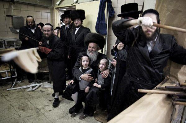 Ultra-Orthodox Jewish men bake unleavened bread for Passover, Jerusalem, March 25 2013, Menahem Kahana