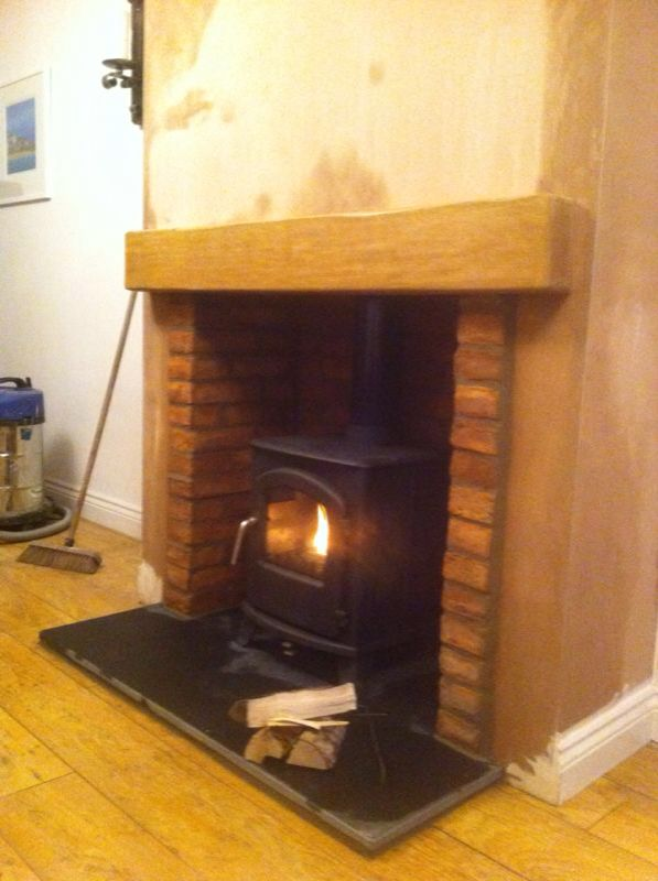 Broseley serrano 5 in a false chimney breast with brick for Tiled chimney breast images