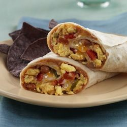 Warm tortillas spread with refried beans and wrapped around an Egg Beaters, cheese and tomato filling for a quick meatless meal