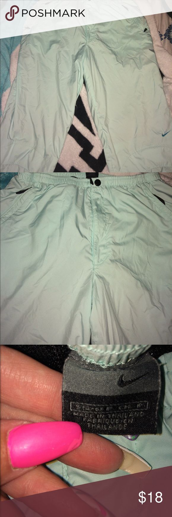 Women's Nike Capris Women's Nike Capri pants they are in great condition size small should fit between a four and six. They are 30 inches in length. Inseam is 21 inches. Waist will stretch to 31 inches. Mid rise 10 inches. They come from a smoke free home. Nike Pants Track Pants & Joggers
