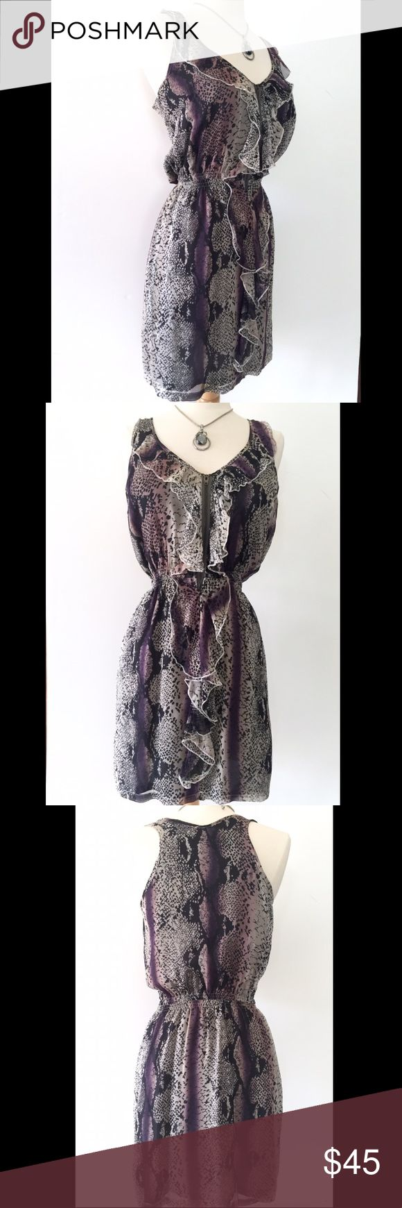 Charlie Jade 100% silk dress snake print Pretty dress from Charlie Jade. In Excellent Condition. No rips, stains or tares. 100% silk. Fully lined. Front zipper from waist to bust. Elastic band at waist for a contour fit. The color is gray, black and some tones of purple. It's above knee length. Charlie Jade Dresses Mini