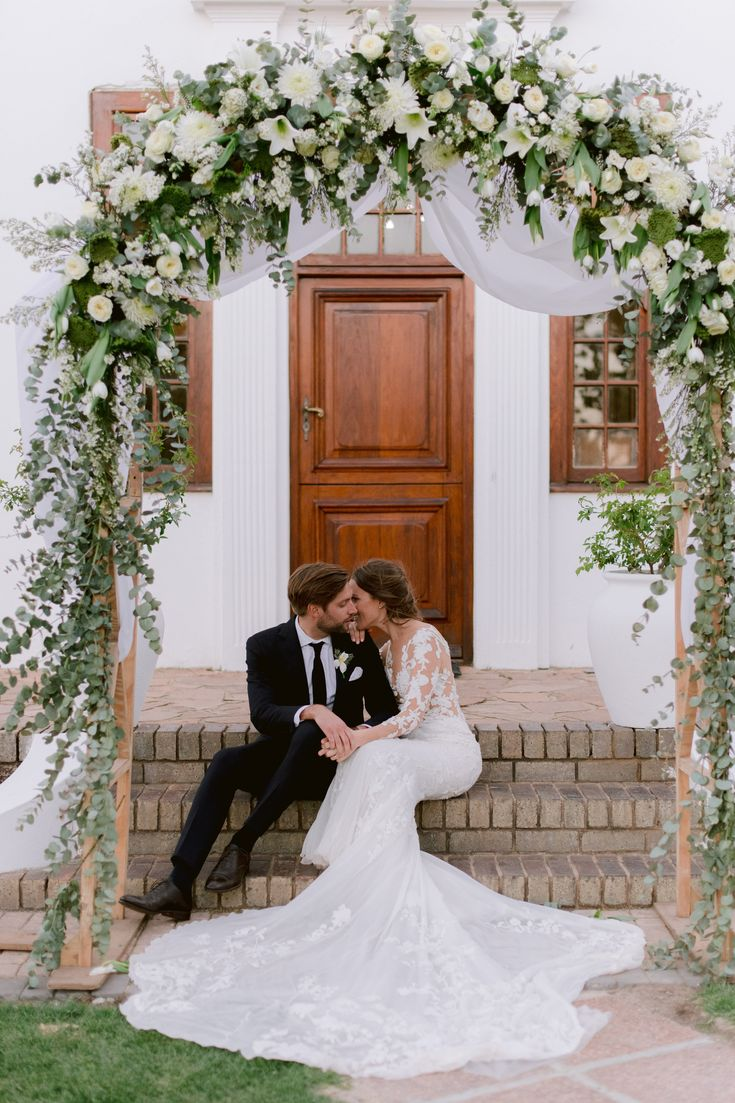 Couple portraits of the bride and groom in front of an old