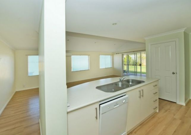 It features well appointed kitchen with gas cook top, wall oven and dishwasher