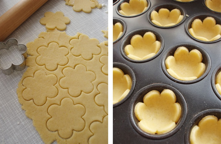 Love this: Cut pie or tart crust dough into flower shapes, bake in a mini cupcake pan, and fill with your favourite filling. Sugar cookie dough would probably work well too.