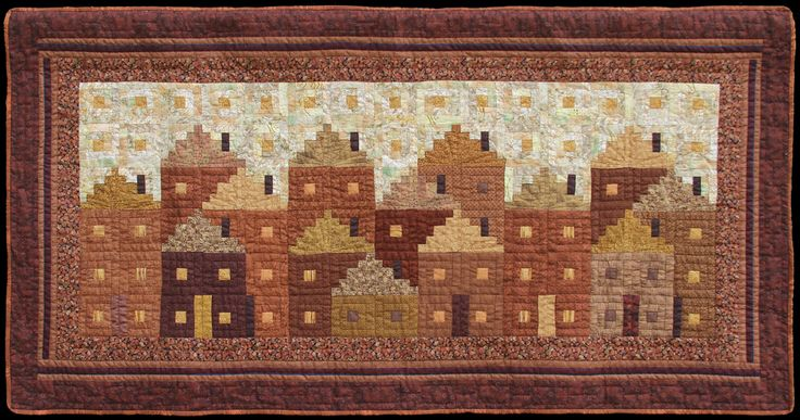 "Brownstones. 51 1/4"" X 26 1/2"" Traditional Log Cabin Machine pieced, handquilted Cottons © 2014 Flavin Glover"