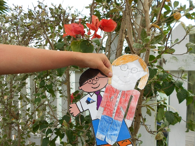 Flat Stanley - St. Thomas Public Library's Character-in-Residence: 2013 Bahamas Adventure, Flat Stanley Goes Gardening,  Bouganvillea Bushes