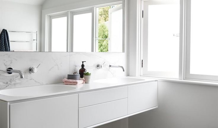 A crisp white palette drapes over every corner of an elegant and minimalistic bathroom space. Featuring black and white marble as the key focal point, there is endless potential to add warmth and character with additional materials or objects.    Designer: @schemesspaces    Builder: Casimark Pty Ltd