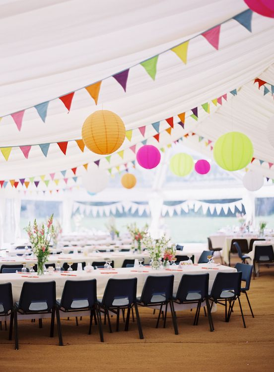 love the bright bunting against the white tent... don't love the chairs though.