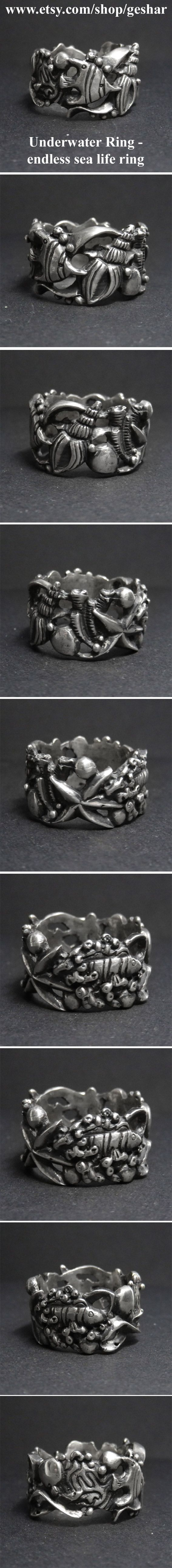 This hand-carved silver ring displays life of the coral reef - fish, conch shells, corals and starfish. Now for sale at www.geshar.etsy.com  #art #shopping #style #silver #silverjewelry #sea #ocean #sealife #fish #coralreef #reef #underwater #handmadewithlove #handmade #handmadejewelry #etsy #etsyseller #etsyshop #etsyfinds #shopetsy
