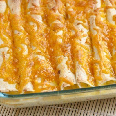 Breakfast Enchiladas - the filling is meat, cheese, veggies and the eggs are poured over the rolled and filled tortillas.  This sounds fairly simple and really tasty.