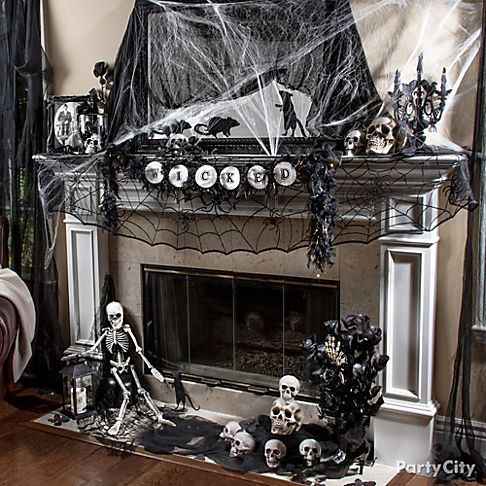 Set the scene for a gothic gala with eerie-n-elegant cobwebs, skulls, rats & roses. Click for deets & more de-FRIGHT-ful fireplace ideas!