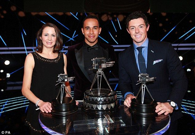 Hamilton (centre) poses alongside runner-up Rory McIlroy (right) and athlete Jo Pavey