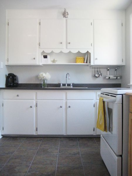 Our little 1940s kitchen!  Benjamin Moore Stonington Gray kitchen with yellow and white accents