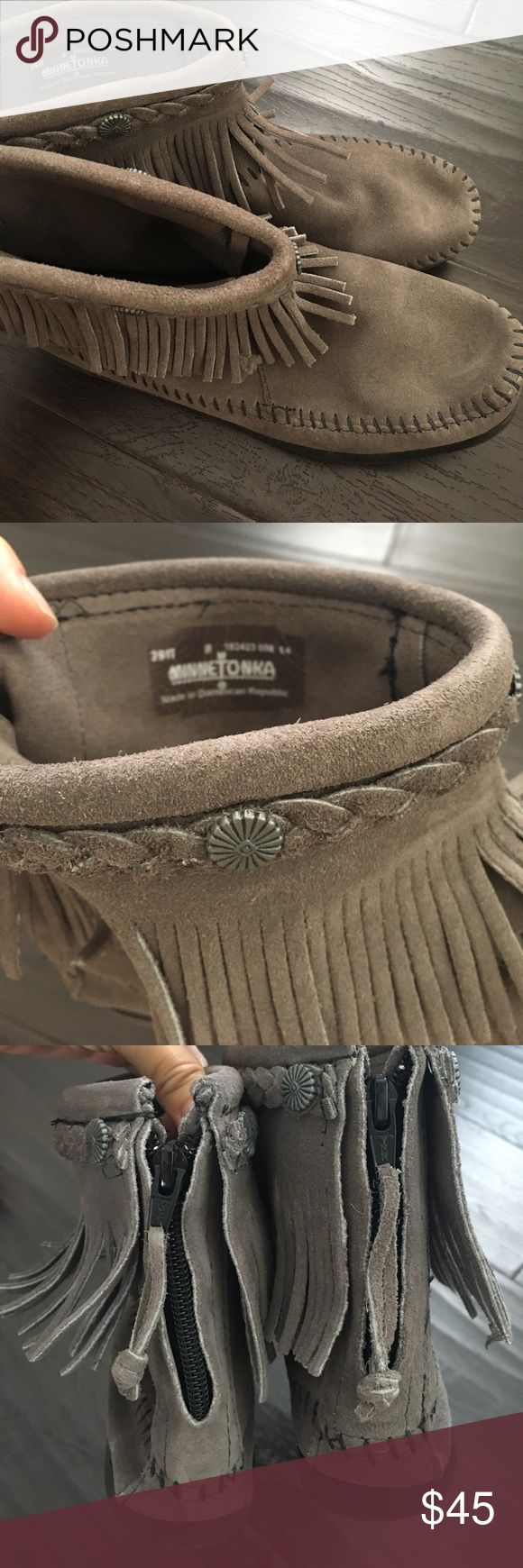 Size 8 Authentic Minnetonka Indian Grey Slippers Practically new Authentic Minnetonka Suede Grey Slippers in size 8.  These were worn out ONLY 1 time but too narrow for my extra wide feet. Minnetonka Shoes Moccasins