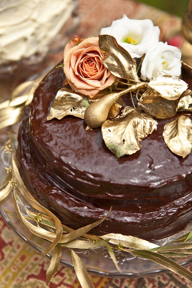 Chocolate cake topped with gold: