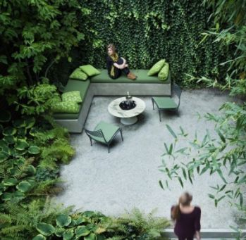 Cool, inviting, private space.  The white/light flooring again looks lovely with lush green planting..