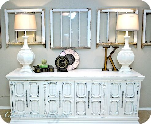 distressed console table - tip junkie. love the old windows and tall lamps! #decorate #distressed #furniture