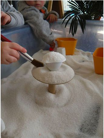 Fine sand and brushes for fine motor development, concentration building, and sensorial exploration.