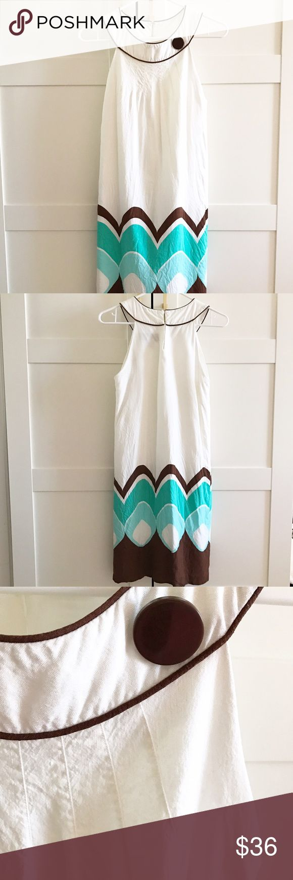 Turquoise and brown print beach dress NWOT Shift dress in linen material with turquoise and brown design and a brown button on the front. Never worn! Tag says size 12, but this has been altered significantly to fit like a size 2. Jessica Howard Dresses Strapless