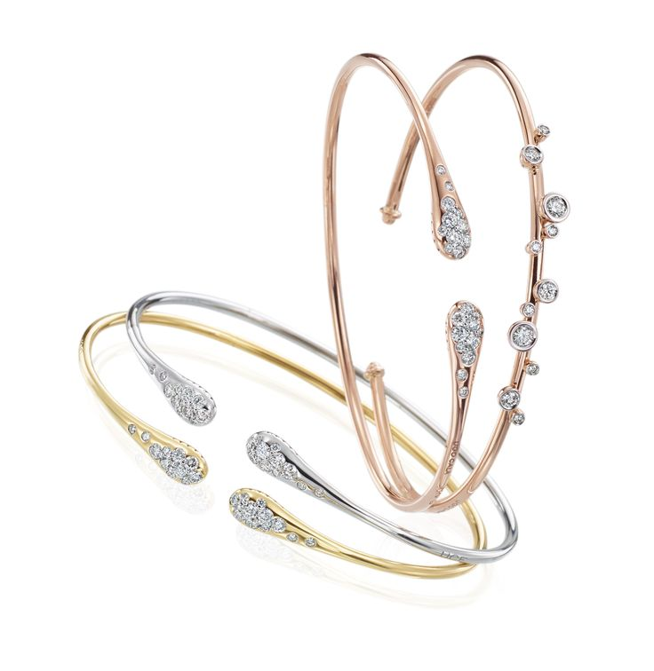 18k White, Yellow and Rose gold bracelets with scattered diamonds by UGO Cala. Available at Razny Jewelers.