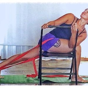 Getting deeper into the twist of #parivrttaparsvakonasana using a chair and a belt to keep the hips even  #iyengar #iye