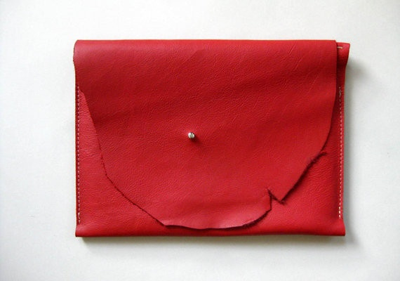 """Perfectly sized for your iPad (no matter which generation), this case is crafted from gorgeous, supple, classic red leather. It's also perfect for carrying around a 10"""" x 7.5"""" molskine notebook or can be used as a clutch or tool pouch. The case features a raw leather edge and metal stud closure.  From Fog + Foundry. $110"""
