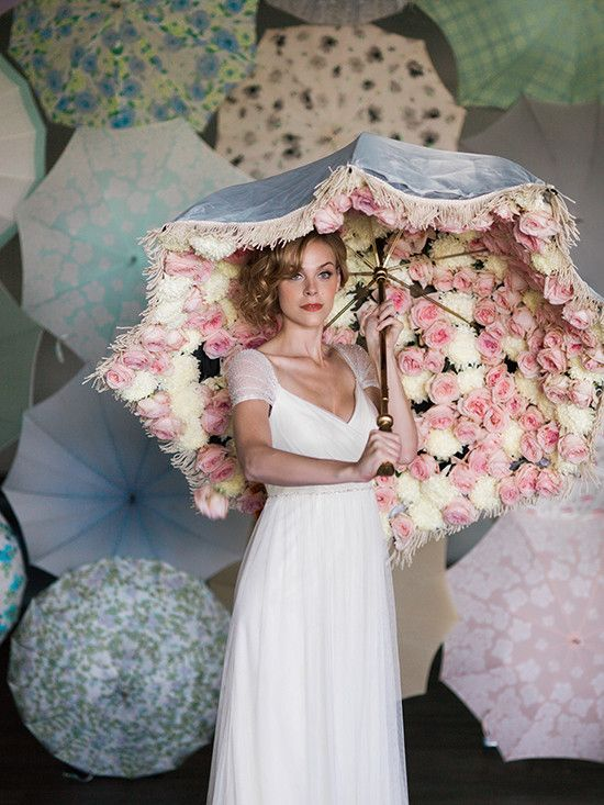 A cute umbrella will allow you to enjoy your big day without ruining your look