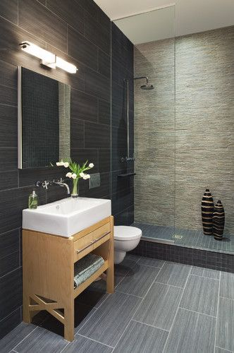 absolutely love the walk in shower with floor to ceiling glass and rock wall, like how the floor tile is just a lighter version of the wall tile