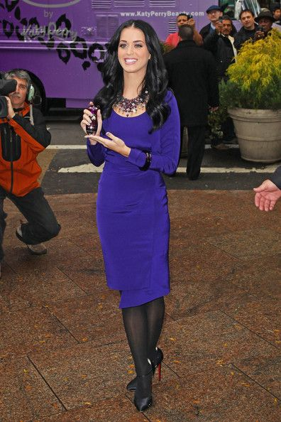 Katy Perry Photos Photos - Katy Perry arrives at the release of her fragrance 'Purr' wearing a purple dress and meeting with fans in a purple truck this afternoon. - Katy Perry at the Release of Her Fragrance