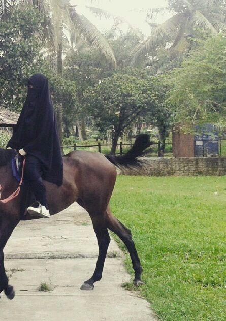 Niqabi on her horse