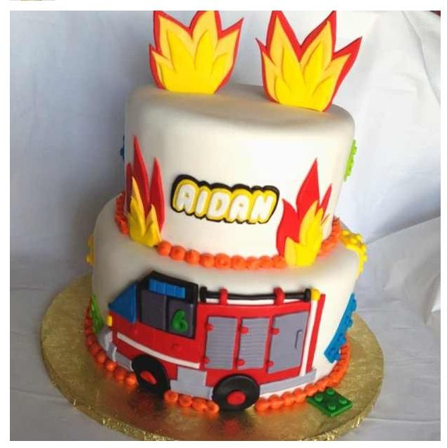Lego City cake :-) logo, legos, and firetruck are handcut in fondant