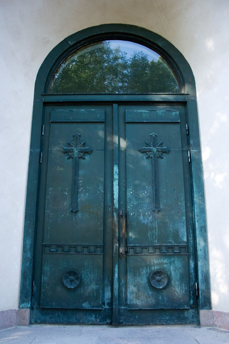 Old door of the Suomenlinna Church 1854, in Helsinki by Aili Alaiso