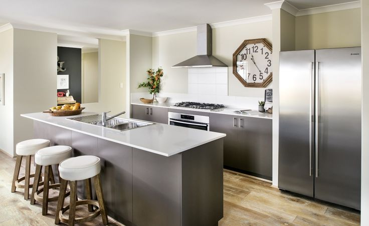 Galley kitchen with 900mm Westinghouse oven, hotplate, rangehood with tiled splashback and large walk in pantry