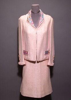 Chanel Powder Pink Wool Suit   French, 1960s   The boxy jacket without closures, pink and blue channel quilted silk lining in jacket, at pocket flaps, cuffs and waist band, chain in jacketWool Suit
