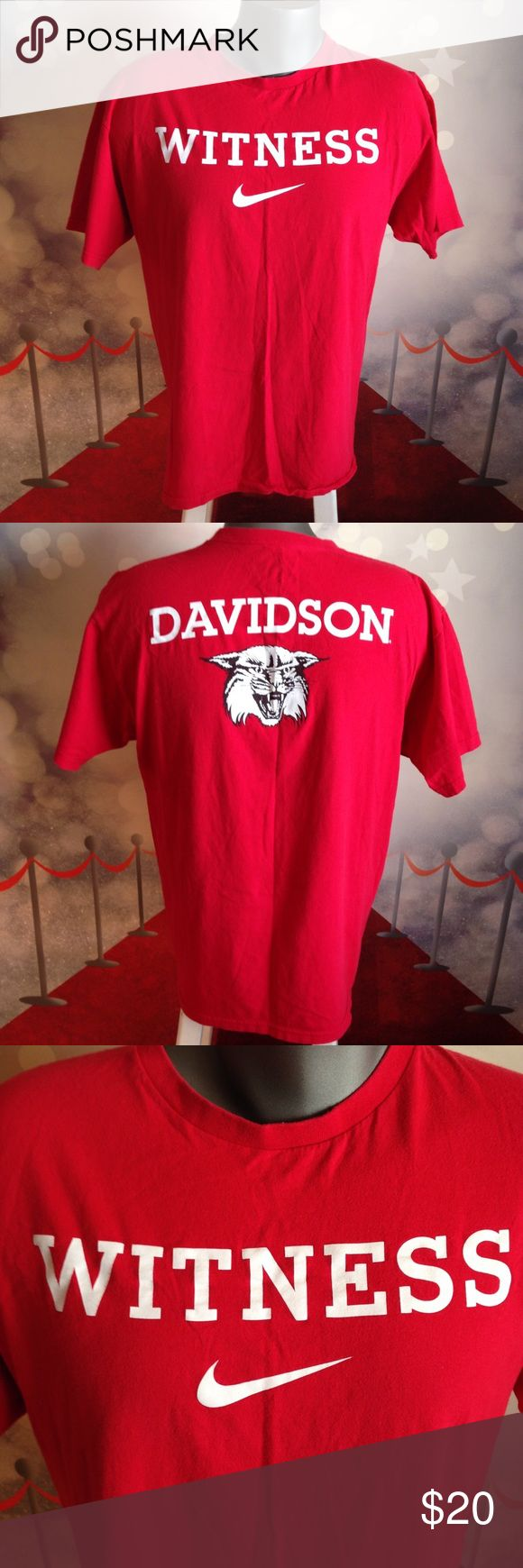 """Nike Lebron James """"Witness"""" Davidson College Nike Lebron James """"Witness"""" T Shirt Red Men's Large Davidson College  """"Witness"""" on front and Davidson college logo on back   Men's Performance T-Shirt  The Nike LeBron Witness Logo solid way to honor a high-flying hoops ruler. A standard fit and rib crew neck make this men's tee shirt comfortable and ready for your next hoops game.   Size: Men's Large  Color: Red   T-Shirt Features  FABRIC: 100% Cotton   Screenprinted graphic center chest and full…"""